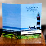 Memorial card with lighthouse on the front