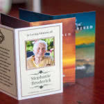 Three memorial cards arranged toghether